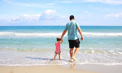 father and child on beach
